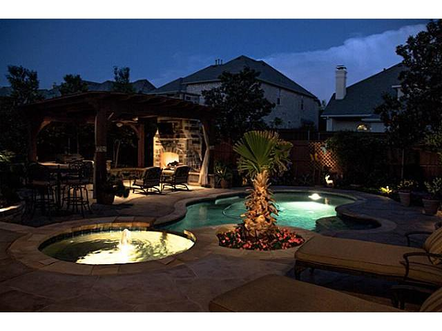 Pool, Spa & Outdoor living area at twilight.